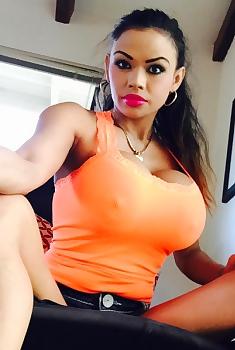Armie Make Selfie In Sexy Orange Top