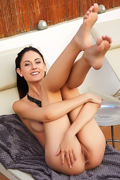 Gorgeous Italian brunette Sade Mare stretches out